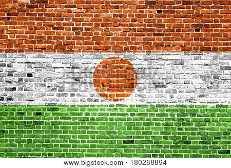Flag of Niger painted on brick wall, background texture