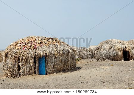 Traditional round house of people from the El Molo tribe on the shore of the lake Turkana in Kenya