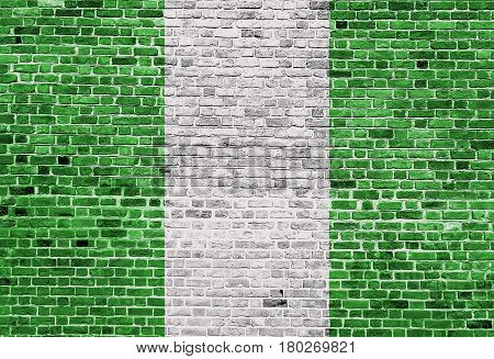 Flag of Nigeria painted on brick wall, background texture