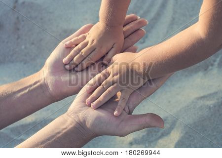 Mother And Small Baby Plays On A Beach