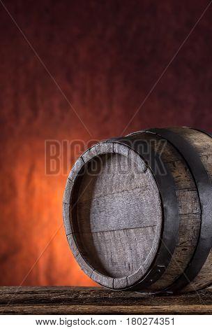Wooden barrel. Old wooden keg. Barel on beer vine whiskey brandy or cognac.