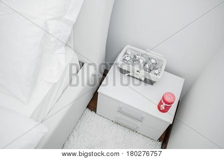 Bedside Table With White Clean And Modern Bedroom With Empty Wall