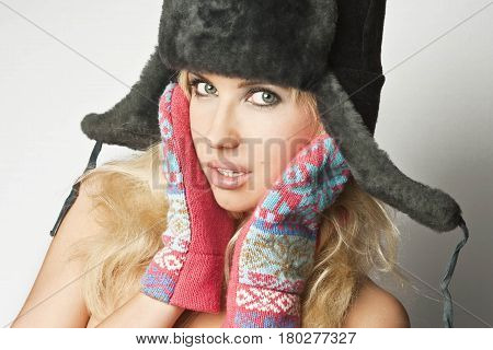 Portrait of pretty blonde with fur hat