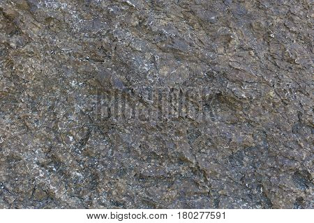 Stone background on mountain side during day