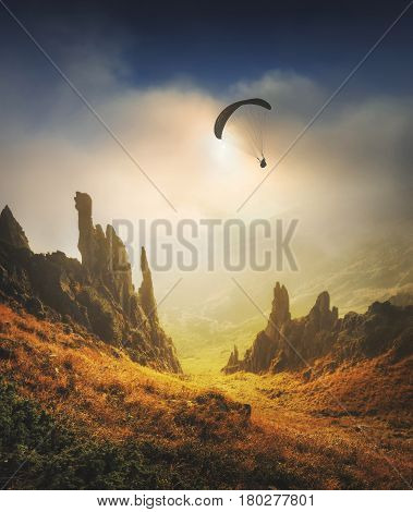 Paraglide Silhouette Flying Over The Mountain Valley