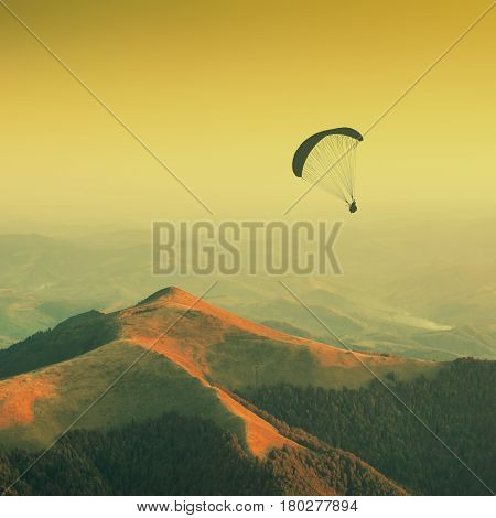 Paraglide Silhouette In A Carpathian Mountains. Vintage