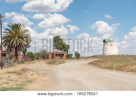 NOUPOORT SOUTH AFRICA - MARCH 21 2017: A street scene with railway houses and a blockhouse from the Boer War in Noupoort a small town in the Northern Cape Province
