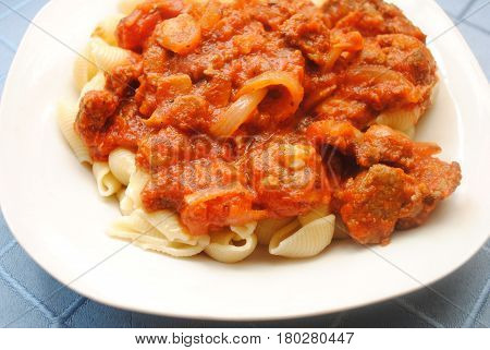 Pasta Shells Served with Chunky Meat Sauce