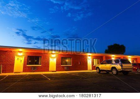 Sunset in touristic motel. USA car travel