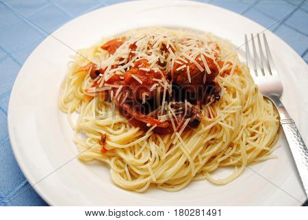 Pasta Served with Cheese and Saucy Meatballs
