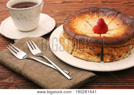 Cottage cheese pie on wooden background. Healthy eating.