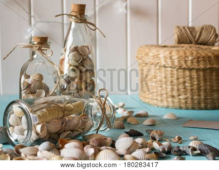 Idea of interior decoration with seashells and glass bottles