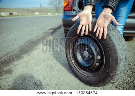 dirty woman hands after car's wheel changing close up