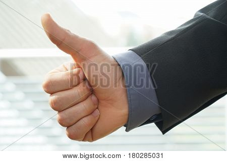businessman shows thumps up or OK sign for his approval
