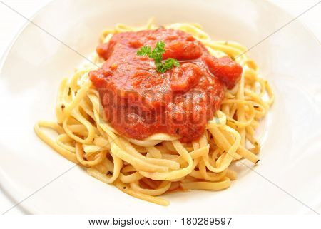 Fettuccine Pasta Served with Tomato Sauce and Parsley