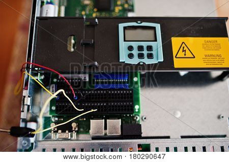 Electrical panel electric meter and circuit breakers. Electric frequency converter motor speed controller rework station. poster