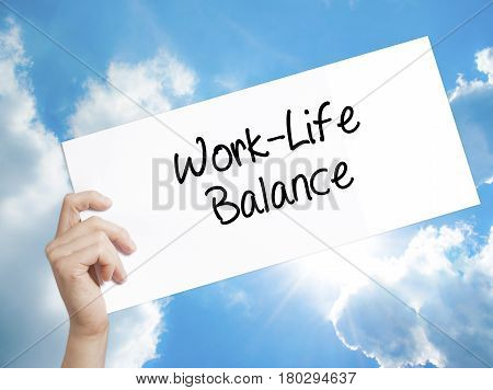 Man Hand Holding Paper With Text Work-life Balance . Sign On White Paper. Isolated On Sky Background