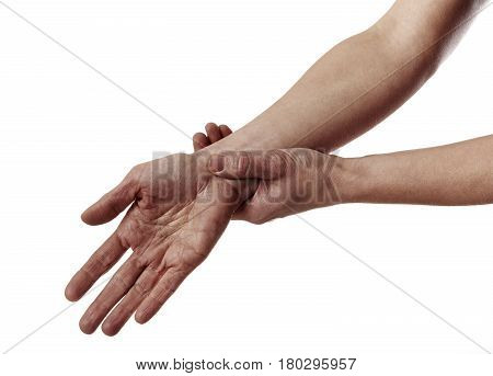 Closeup of human hands having rheumatism over white background. Health care and medicine.