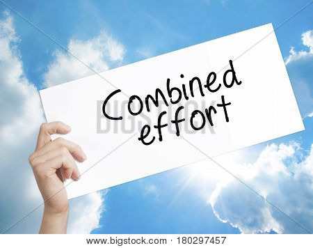 Man Hand Holding Paper With Text Combined Effort . Sign On White Paper. Isolated On Sky Background