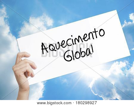Man Hand Holding Paper With Text Aquecimento Global (global Warming In Portuguese) . Sign On White P