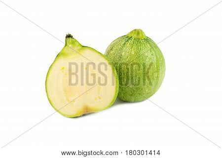 round courgettes raw zucchini on white background
