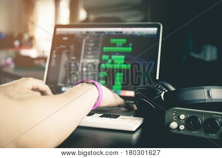 Musician is recording tunes on his computer music