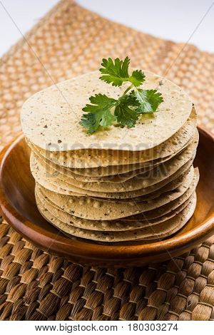 Indian snacks, deep fried crackers or papad. Mung dal and urad dal papad an Indian fried dish, which is an side dish for lunch and dinner.