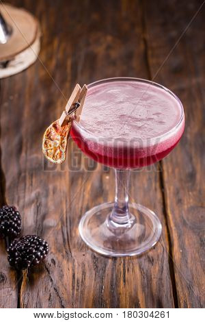 Gin with blackberry liqueur, juice of a lemon and sugar syrup