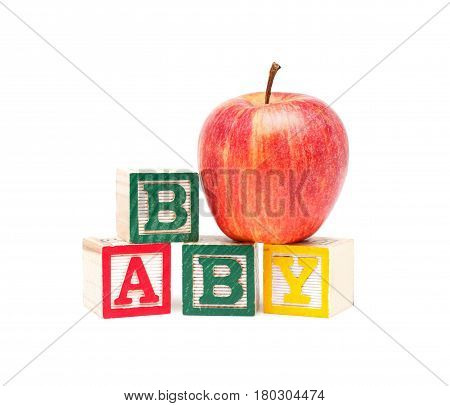 Wooden blocks and apple with baby isolated on white background