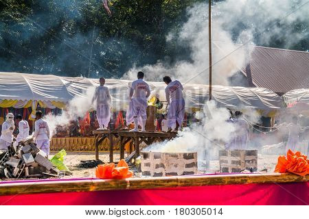 BURIRAM THAILAND - JAN 2 : Buddhist metal cast ceremony for buddha statue Pouring molten metal in mold . Jan 22017 in Lok Molee Temple Buriram Thailand.