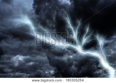 Lightning strike with dramatic dark clouds in the sky.