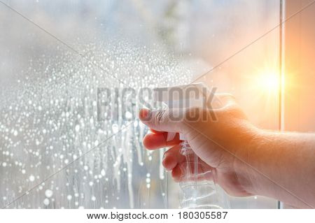 Cleaning Windows Using The Spray.