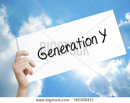 Man Hand Holding Paper With Text Generation Y . Sign On White Paper. Isolated On Sky Background