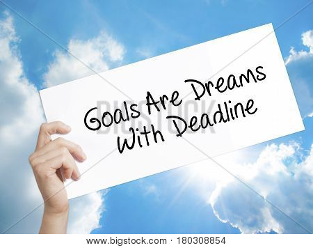 Man Hand Holding Paper With Text Goals Are Dreams With Deadline . Sign On White Paper. Isolated On S