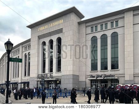 BRONX NEW YORK - MARCH 28: People gather outside for FDNY & NYPD game at Yankee Stadium hosted by NYCFC. Taken March 28 2017 in New York.
