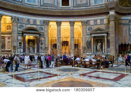 ROME - OCTOBER 2, 2012: Tourists visit in the pantheon in Rome, Italy. Pantheon is a famous monument of ancient Roman culture, the temple of all the gods built in the 2nd century.