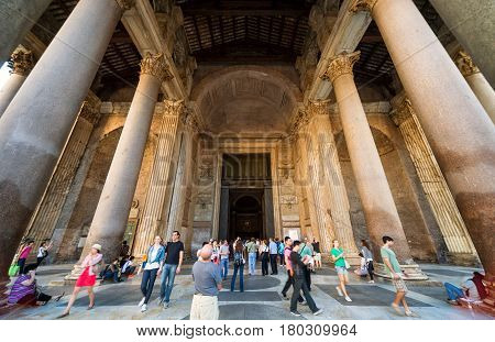 ROME - OCTOBER 2, 2012: Tourists visit the Pantheon. Pantheon is a famous monument of ancient Roman culture, the temple of all the gods built in the 2nd century.