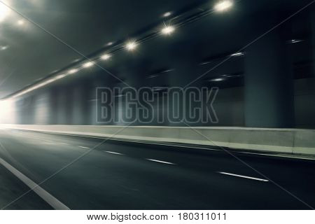 futuristic motion blur road in tunnel, fast moving street background