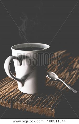 Coffee cup with steam set in low light backgroundCoffee in love concept.Matte stylevintage style.(Selective focus)