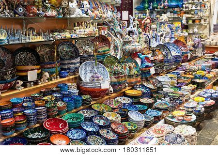 ISTANBUL - MAY 27, 2013: Turkish ceramics on the Grand Bazaar in Istanbul, Turkey. The Grand Bazaar is the oldest and the largest covered market in the world with 61 covered streets and over 3000 shops.