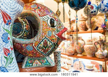 ISTANBUL - MAY 27, 2013: Turkish ceramics in the Grand Bazaar in Istanbul, Turkey. The Grand Bazaar is the oldest and the largest covered market in the world with 61 covered streets and over 3000 shops.