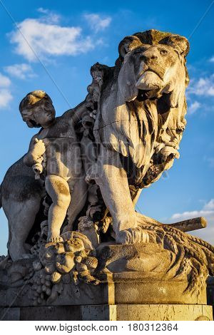 Statue of a lion on the Pont Alexandre III in Paris, France. This bridge was named after russian Tsar Alexander III.