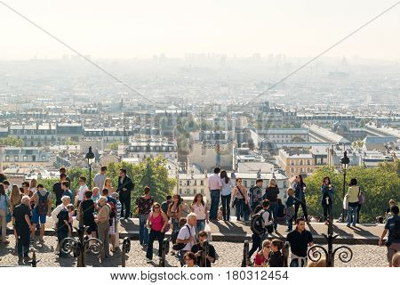 PARIS - SEPTEMBER 24: View of Paris from the Sacre Coeur in Montmartre hill on september 24, 2013 in France. Montmartre is a historic district is always full of tourists.
