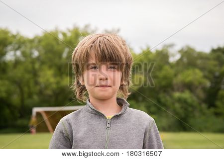 Portrait of a young boy in park