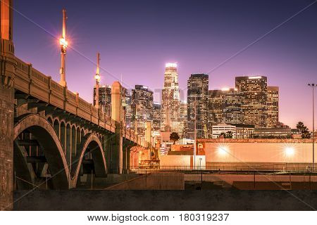 Skyscrapers in downtown Los Angeles California at night. View from under the bridge