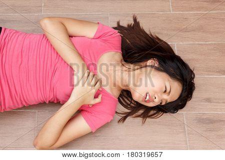 Sporty woman having heart attack at park- Angina Pectoris Myocardial Infarction