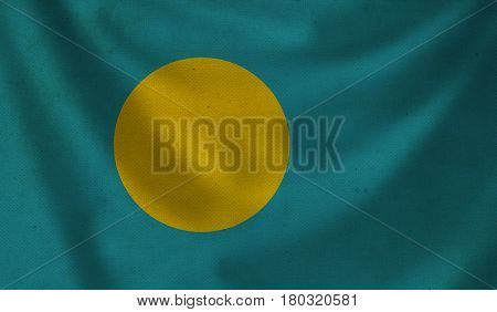 Vintage background with flag of Palau. Grunge style.
