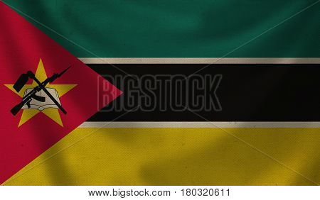 Vintage background with flag of Mozambique. Grunge style.