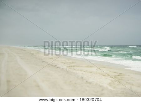 Beautiful beach on a stormy day in Florida on the Gulf of Mexico with fog mist and sea spray