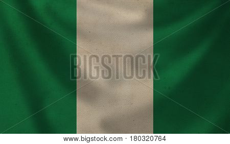 Vintage background with flag of Nigeria. Grunge style.